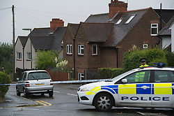 © London News Pictures. 23/09/2012. Guildford, UK.  A police officer guarding the crime scene on the corner of Roundhill way and Fairfield Rise in Guildford where a 19 year-old man was stabbed to death yesterday evening (Sat). An 18-year-old man has been arrested on suspicion of murder.  Photo credit : Ben Cawthra/LNP.