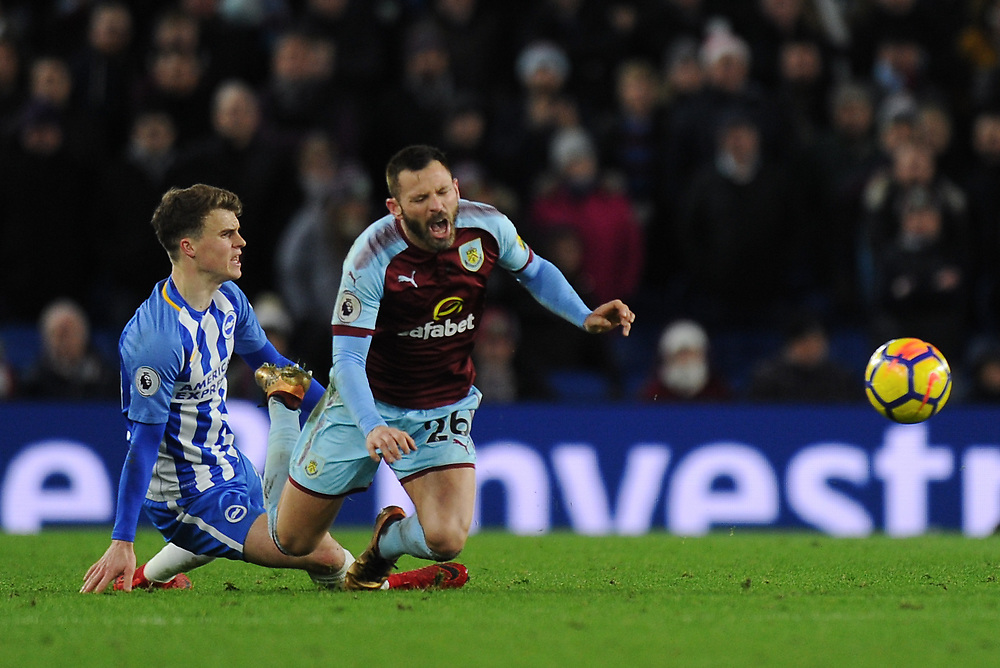 Burnley's Phillip Bardsley is fouled by Brighton & Hove Albion's Solly March<br /> <br /> Photographer Ashley Western/CameraSport<br /> <br /> The Premier League - Brighton and Hove Albion v Burnley - Saturday 16th December 2017 - The Amex Stadium - Brighton<br /> <br /> World Copyright © 2017 CameraSport. All rights reserved. 43 Linden Ave. Countesthorpe. Leicester. England. LE8 5PG - Tel: +44 (0) 116 277 4147 - admin@camerasport.com - www.camerasport.com