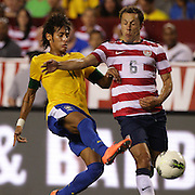 Neymar, Brazil, (left) is challenged by Steve Cherundolo, USA, during the USA V Brazil International friendly soccer match at FedEx Field, Washington DC, USA. 30th May 2012. Photo Tim Clayton