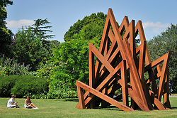"""© Licensed to London News Pictures. 05/07/2017. London, UK. """"17 Acute Unequal Angles"""", 2016, by Bernar Venet.  The Frieze Sculpture festival opens to the public in Regent's Park.  Featuring outdoor works by leading artists from around the world the sculptures are on display from 5 July to 8 October 2017.  Photo credit : Stephen Chung/LNP"""
