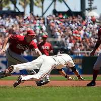 19 April 2009: Arizona Diamondbacks' starting pitcher Max Scherzer tags out San Francisco Giants' Emmanuel Burriss as first base Tony Clark watches during the San Francisco Giants' 2-0 win  against the Arizona Diamondbacks at AT&T Park in San Francisco, CA.