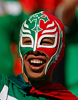 Photo: Glyn Thomas.<br />Mexico v Iran. Group D, FIFA World Cup 2006. 11/06/2006.<br /> A Mexican fan wearing a facemask.