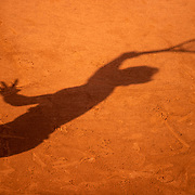 PARIS, FRANCE June 5.  The shadow of Rafael Nadal of Spain on the clay court surface as he serves against Cameron Norrie of Great Britain on Court Suzanne Lenglen during the third round of the singles competition at the 2021 French Open Tennis Tournament at Roland Garros on June 5th 2021 in Paris, France. (Photo by Tim Clayton/Corbis via Getty Images)