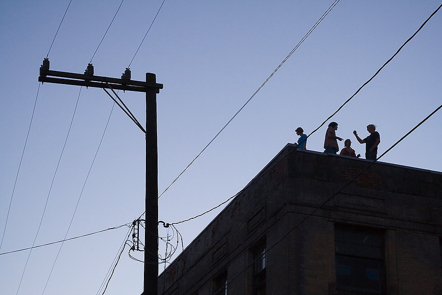Young adults party on a roof during a hip hop show by the Blue Scholars at the Capitol Hill Block Party in Seattle, Washington.