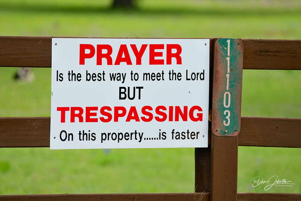 Humorous no tresspassing sign on a rural property, Llano County CR 310, Texas, USA