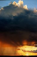 sunset with rain and light rays over Arizona