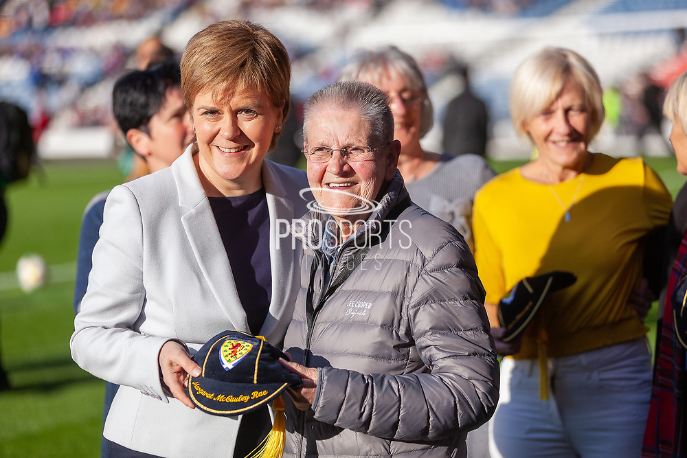 First Minister Nicola Sturgeon pictured with Margaret McCauley Rae receiving her Scotland Cap ahead of the International Friendly match between Scotland Women and Jamaica Women at Hampden Park, Glasgow, United Kingdom on 28 May 2019.