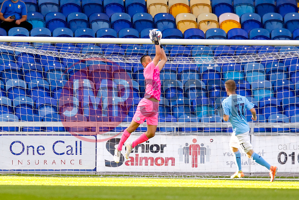 James Trafford of Manchester City jumps to make a save - Mandatory by-line: Ryan Crockett/JMP - 08/09/2020 - FOOTBALL - One Call Stadium - Mansfield, England - Mansfield Town v Manchester City U21 - Leasing.com Trophy