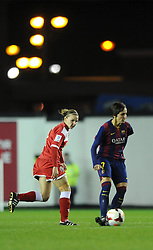 Bristol Academy Womens' Loren Dykes chases down FC Barcelona's Marta Corredera - Photo mandatory by-line: Dougie Allward/JMP - Mobile: 07966 386802 - 13/11/2014 - SPORT - Football - Bristol - Ashton Gate - Bristol Academy Womens FC v FC Barcelona - Women's Champions League