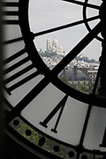 View of the Sacré-Couer Basilica through the Musée d'Orsay museum Clock