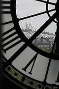 View of the Sacré-Couer Basilica through the Musée d'Orsay museum Clock