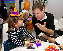© London News Pictures. 31/10/2013 . London, UK. NICK CLEGG talking to GOSH patient ELIZABETH BURROWS (aged 4). Deputy Prime Minister nick Clegg and his wife Miriam Gonzalez Durantz meet children, parents and volunteers at the Great Ormond Street Hospital annual Halloween party.  Photo credit : Ben Cawthra/LNP