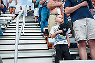 NASCAR fans stand during the singing of the National Anthem at Bristol Motor Speedway on March 18, 2012