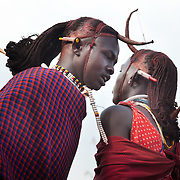 Wilson's wedding day...Young men called Morans are competing in jumping as high and straight as possible, a competitive dance called adumu, at Wilson's wedding. The Morans are you men almost ready for the coming of age ceremony held every 10-15 years...It is mainly Maasais who live in the Loita Hills up above the Serengeti plains. They live in small villages and communities called bomas and live mainly of raising and selling live stock such as cattle and goats. Its a very remote region in Kenya, hard to get to without a four wheel drive with very little infrastructure and up till 2010 no mobile phone network. The Maasais are well known though out Kenya and the world for their colorful clothing and their way of keeping their old traditions alive.
