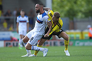 Aaron Wilbraham tussles with a Burton defender during the EFL Sky Bet League 1 match between Burton Albion and Rochdale at the Pirelli Stadium, Burton upon Trent, England on 4 August 2018.