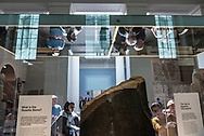 Visitors to the British Museum in London examine the Rosetta Stone. (May 4, 2018)