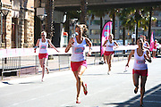 The 'Venus Embrace Closest Stiletto Relay' in Sydney on September 28, 2010. Paul Lovelace Photography. An official world record was set at the event for the fastest ever 4 x 100m stiletto relay, which saw women in teams of four running in stilettos with a minimum height of 3 inches, to help raise funds to find a cure for breast cancer.. An instant sale option is available where a price can be agreed on image useage size. Please contact me if this option is preferred.