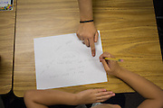 Third grade teacher Laura Polden talks with a student during a brainstorming exercise on the first day of school at Zanker Elementary School in Milpitas, California, on August 19, 2013. (Stan Olszewski/SOSKIphoto)