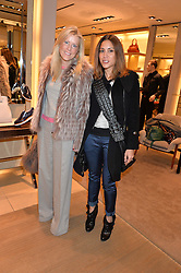 Left to right, OLIVIA McCALL and LILY HODGES at a Valentine's Ladies breakfast hosted by Tod's and Carolina Bonfiglio at the Tod's boutique in New Bond Street, London on 10th February 2015.