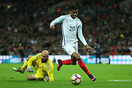 Marcus Rashford of England goes past Goalkeeper Pepe Reina of Spain but fails to score. England v Spain, Football international friendly at Wembley Stadium in London on Tuesday 15th November 2016.<br /> pic by John Patrick Fletcher, Andrew Orchard sports photography.