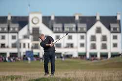 Actor Hugh Grant has to play from the thick rough after slicing his tee shot at the 17th hole during day two of the Alfred Dunhill Links Championship at Carnoustie Golf Links, Angus.