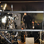 Media outlets setup their cameras facing the US Capitol building in preparation of the next day's inauguration.