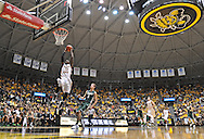 WICHITA, KS - NOVEMBER 14:  Forward Nick Wiggins #15 of the Wichita State Shockers drives in for a dunk against the William & Mary Tribe during the first half on November 14, 2013 at Charles Koch Arena in Wichita, Kansas.  Wichita State defeated William & Mary 79-62. (Photo by Peter Aiken/Getty Images) *** Local Caption *** Nick Wiggins
