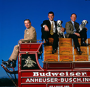 Patrick T. Stokes (right) president and CEO of Anheuser-Busch, August A. Busch III (top left) is the Chairman of the Board and his son August A. Busch IV (middle) is president of the beer company.