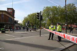 © Licensed to London News Pictures. 28/05/2021. London, UK. Police officers guard a crime scene outside Turnpike Lane Underground station in north London, following a death of a man. Police were called at just after 1am on Friday, 28 May to reports of a firearm discharge in the vicinity of Turnpike Lane. Police officers, the London Ambulance Service and London's Air Ambulance attended the scene. A man, believed to be aged in his 20s, was found suffering a gunshot injury. Despite the efforts of the emergency services he was pronounced dead at the scene at just before 2am. Photo credit: Dinendra Haria/LNP