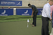SALOUM N'JIE, Alfred Dunhill Million Dollar Putt, the Dunhill Clubhouse. Broadgate Arena.London EC2. 25 July 2006.  ONE TIME USE ONLY - DO NOT ARCHIVE  © Copyright Photograph by Dafydd Jones 66 Stockwell Park Rd. London SW9 0DA Tel 020 7733 0108 www.dafjones.com