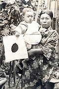 young adult woman in traditional kimono standing with toddler baby ca 1930s Japan