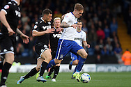 Lee Erwin of Bury gets away from Yanik Wildschut of Wigan Athletic. Skybet football league one match , Bury v Wigan Athletic at the JD Stadium in Bury, Lancs on Saturday 10th October 2015.<br /> pic by Chris Stading, Andrew Orchard sports photography.
