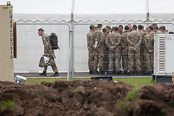 © licensed to London News Pictures. London, UK 18/07/2012. Soldiers waiting at their military base in Hainault Country Park in Redbridge, east London. The base will accommodate 3,000 soldiers during the Olympics. Photo credit: Tolga Akmen/LNP