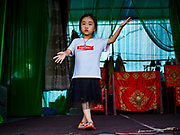 26 AUGUST 2018 - GEORGE TOWN, PENANG, MALAYSIA: A child performer rehearses before going on stage for a Hokkien style Chinese opera on the Lim Jetty in George Town for the Hungry Ghost Festival. The opera troupe came to George Town from Fujian province in China. The Hungry Ghost Festival is a traditional Buddhist and Taoist festival held in Chinese communities throughout Asia. The Ghost Festival, also called Ghost Day, is on the 15th night of the seventh month (25 August in 2018). During the Hungry Ghost Festival, the deceased are believed to visit the living. In many Chinese communities, there are Chinese operas and puppet shows and elaborate banquets are staged to appease the ghosts.     PHOTO BY JACK KURTZ