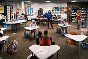 17 FEBRUARY 2021 - DES MOINES, IOWA: AMY LAUG, left, Principal at Walnut Street School, and STEPHANIE EDENBURN, 4th grade teacher, talk to students in Edenburn's classroom. Des Moines Public Schools (DMPS) opened to in person education this week after teaching most of the 2020-2021 school year either remotely or with a hybrid/remote learning model. The district has ended its hybrid model. The Governor of Iowa has aggressively pushed schools to return to in person education, going so far as to threaten to withhold funds from districts that don't return to in person classes. DMPS, the largest school district in Iowa, has resisted the Governor's push because Polk County, IA, has been a Coronavirus/COVID-19 hotspot with positivity rates well above 10 percent. The district was recently able to vaccinate many teachers and positivity rates have fallen to 9 percent, making it safer to reopen schools.    PHOTO BY JACK KURTZ