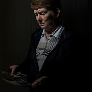 Local historian Catherine Corless contemplates childhood photographs in her house in the outskirts of Tuam, Ireland. Corless's investigation into a burial site in St. Mary's Mother and Baby Home in Tuam, where she believed 796 children, most of them infants, were interred between 1925 and 196, proved to be right when a state-financed investigation uncovered the remains of babies, small children and foetuses interred where she said they would.