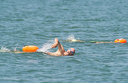 © Licensed to London News Pictures 22/07/2021. Whitstable, UK. A man swimming in the sea. Another hot heatwave day as people enjoy a day out at Whitstable in Kent.  Photo credit:Grant Falvey/LNP
