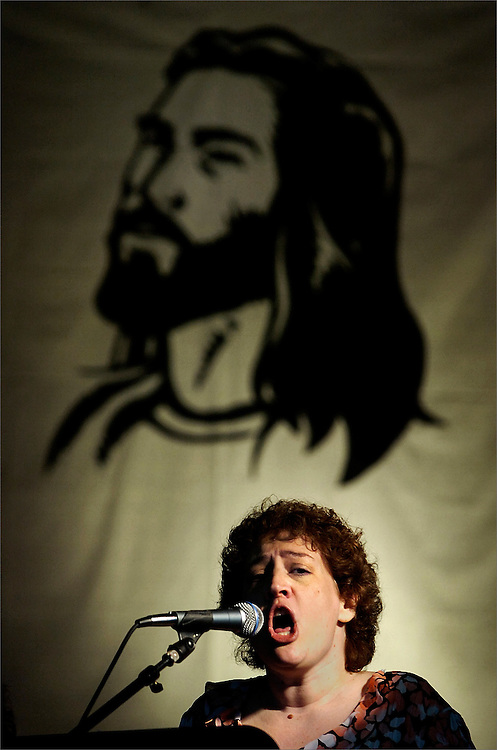 """St. Joseph of Hillsborough Youth Band member Laurie Ferretti sings the song """"Your Grace Is Enough"""" to welcome participants to the """"Diocese of Metuchen Youth Day"""" held at Cardinal McCarrick High School in South Amboy, New Jersey on March 21, 2009."""