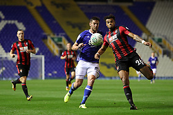 AFC Bournemouth's Tyrone Mings (right) and Birmingham City's Lukas Jutkiewicz battle for the ball during the Carabao Cup, Second Round match at St Andrew's, Birmingham.