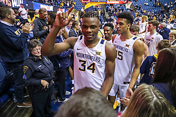 Dec 14, 2019; Morgantown, WV, USA; West Virginia Mountaineers forward Oscar Tshiebwe (34) and West Virginia Mountaineers forward Jalen Bridges (15) celebrates with fans after defeating the Nicholls State Colonels at WVU Coliseum. Mandatory Credit: Ben Queen-USA TODAY Sports