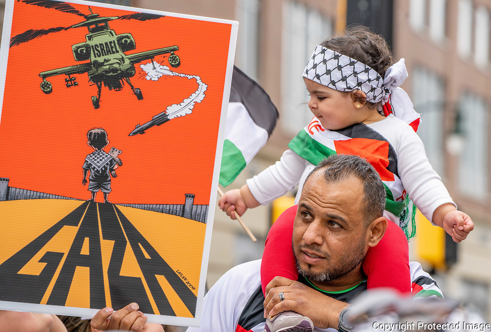 Ihab Hussein, 38, Allentown, Pennsylvania, attends a Palestine solidarity rally with his 16-month-old daughter, Liliann at the war memorial in downtown Allentown.