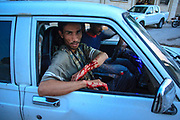 A makeshift emergency response vehicle brings wounded soldiers bleeding following a military operation in Anadan on Monday, June 25, 2012. Anadan, bears the scars from Syrian President Bashar al-Assad's use of military force to crush an opposition movement that has spawned an armed insurgency against his rule. (Photo by Vudi Xhymshiti)