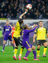 Nicolas Pareja of Sevilla vs Marcos Tavares #9 of Maribor during football match between NK Maribor and Sevilla FC (ESP) in 1st Leg of Round of 32 of UEFA Europa League 2014 on February 20, 2014 at Stadium Ljudski vrt, Maribor, Slovenia. Photo by Vid Ponikvar / Sportida