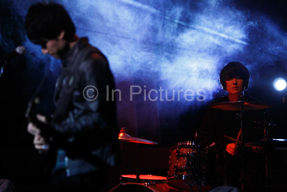 Chinese indie rock trio Carsick Cars perform during a taping of the English language talk show Asia Uncut in Shanghai, China on 15 December 2009. Carsick Cars is one of the most popular alternative rock bands in China.