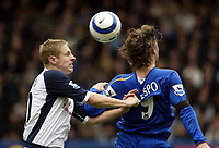 Photo: Chris Ratcliffe.<br />Chelsea v Tottenham Hotspur. The Barclays Premiership. 11/03/2006.<br />Michael Dawson (L) of Spurs competes with Hernan Crespo for the ball.