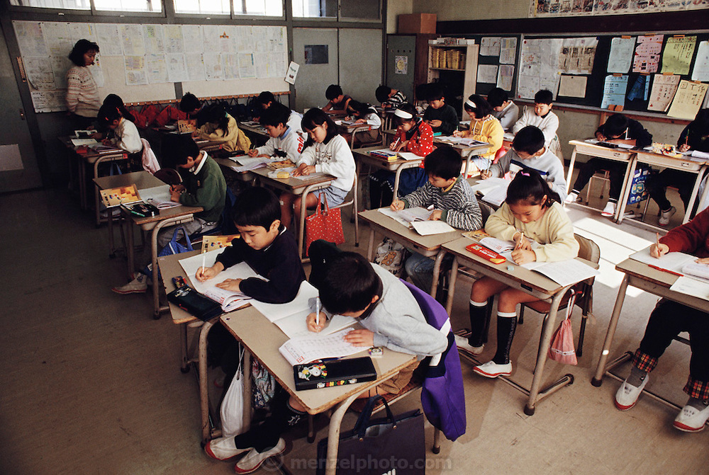 Mio Ukita and her Kodaira City classmates do math problems in their schoolroom. Japan. Material World Project. The Ukita family lives in a 1421 square foot wooden frame house in a suburb northwest of Tokyo called Kodaira City.