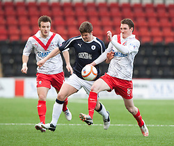 Falkirk's Stewart Murdoch  and Airdrie United's Sean Lynch..Airdrie United 0 v 1 Falkirk, 30/3/2013..©Michael Schofield..