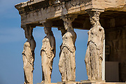 The most famous caryatids, supportive goddesses used instead of pillars. They stand guard over the Erechtheion of the Acropolis, Athens, Greece. This ancient temple honored Athena and Poseidon.