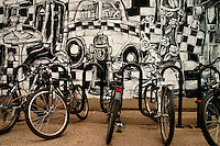 Parked bicycles and black and white wall mural, Hamilton Street, downtown Regina Saskatchewan