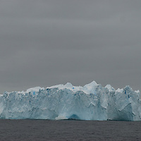 An iceberg floats off the Antarctic Peninsula, near the Antarctic Circle , Antarctica.